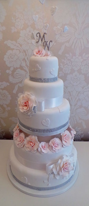 5 tier wedding cake with hearts and roses