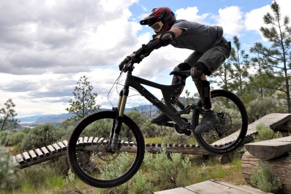 Coach Jim Flux demonstrates bike-handling skills amid the sagebrush of the Kamloops Bike Ranch.