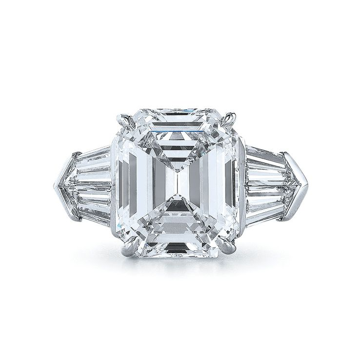Emerald Cut Diamond and Platinum Beautiful. Ring with Four Tapered Baguettes in a Unique Design