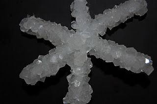 Easy to make borax crystal snowflakes.  Great ornament for the tree the kids can do!