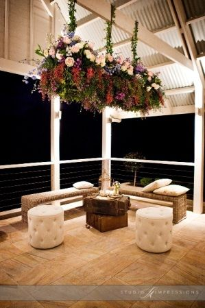 Tiffany button ottomans. Spectacular suspended floral arrangements by Mondo Floral Designs, at Maleny Manor x