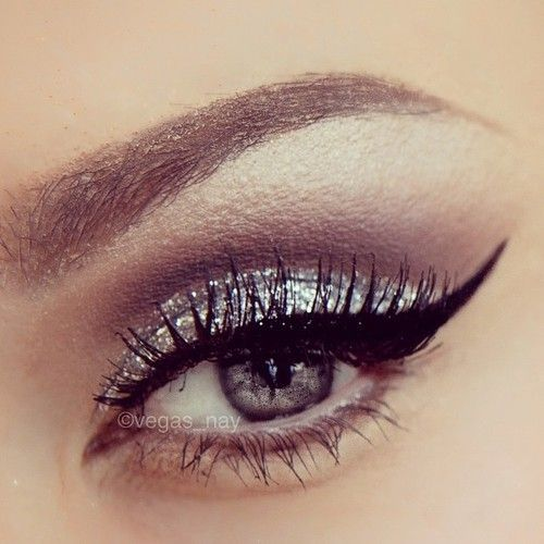 Glittery eyeshadow and winged eyeliner. Very glam! Could be good for prom!