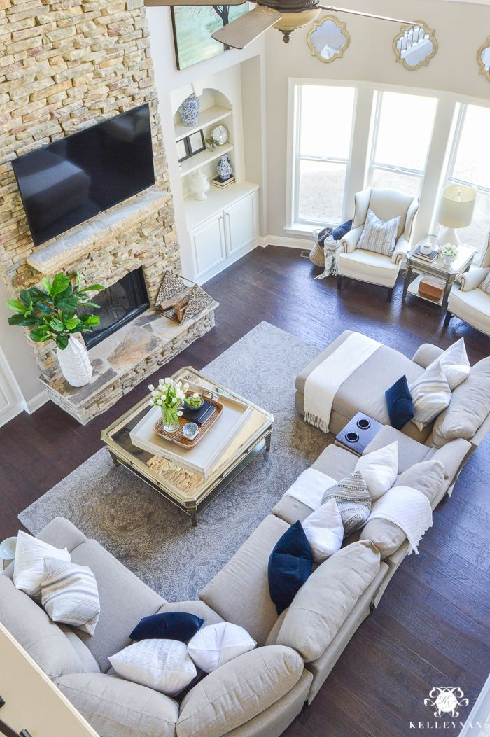 Decked and Styled Spring Home Tour - Kelley Nan- two story living room or great room with nottaway hickory hardwoof floors, stacked stone fireplace, and la-x-boy sectional. Big windows and blue and white decor