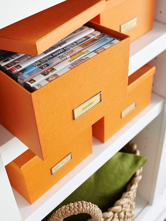 Organize movies by genre with pretty boxes like these http://store.franklinplanner.com/store/category/prod410028/US-Closet-Room-Organization/Flora-DVD-Box-by-Design-Ideas-?skuId=39245