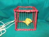 Neil Sweet vanishing bird cage