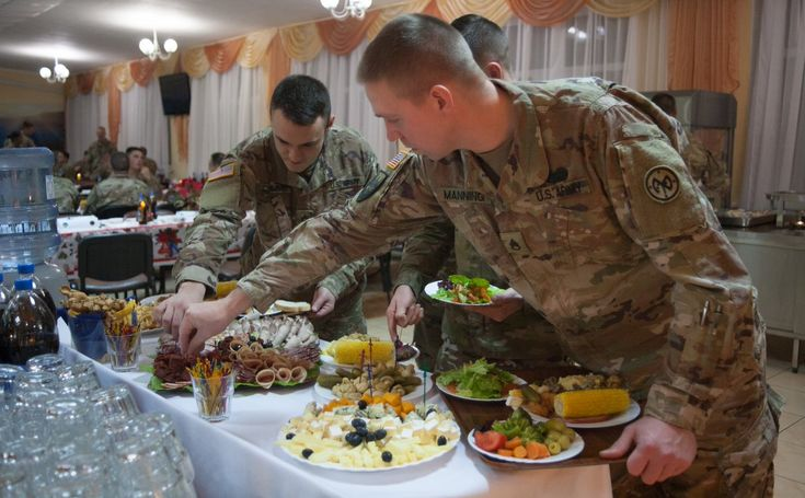 Yavoriv, Ukraine – While most of their families back home in New York were waking up and unwrapping presents, the more than 220 men and women of the Joint Multinational Training Group – Ukraine were just sitting down to their Christmas dinner