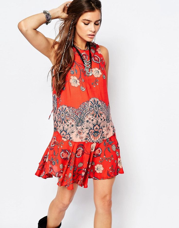 Image 1 ofFree People Printed Dobby Dot Flouncy Hem Slip Dress