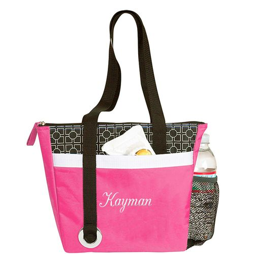 "Chic Cooler Bag Size: 11-1/4""W x 10""H x 3""D Out with the brown bag and in with the So Fab! Our Stylish Mini Cooler Tote Bag is just the accessory you need to keep you looking chic! This adorable cooler bag is made of a bright pink durable fabric and features a trendy black and white accent panel. The long black strap is attached in a funky fashion, accented with a chunky silver grommet. The front of the cooler features a slim pocket that can hold a cell phone or other small items. The bag…"
