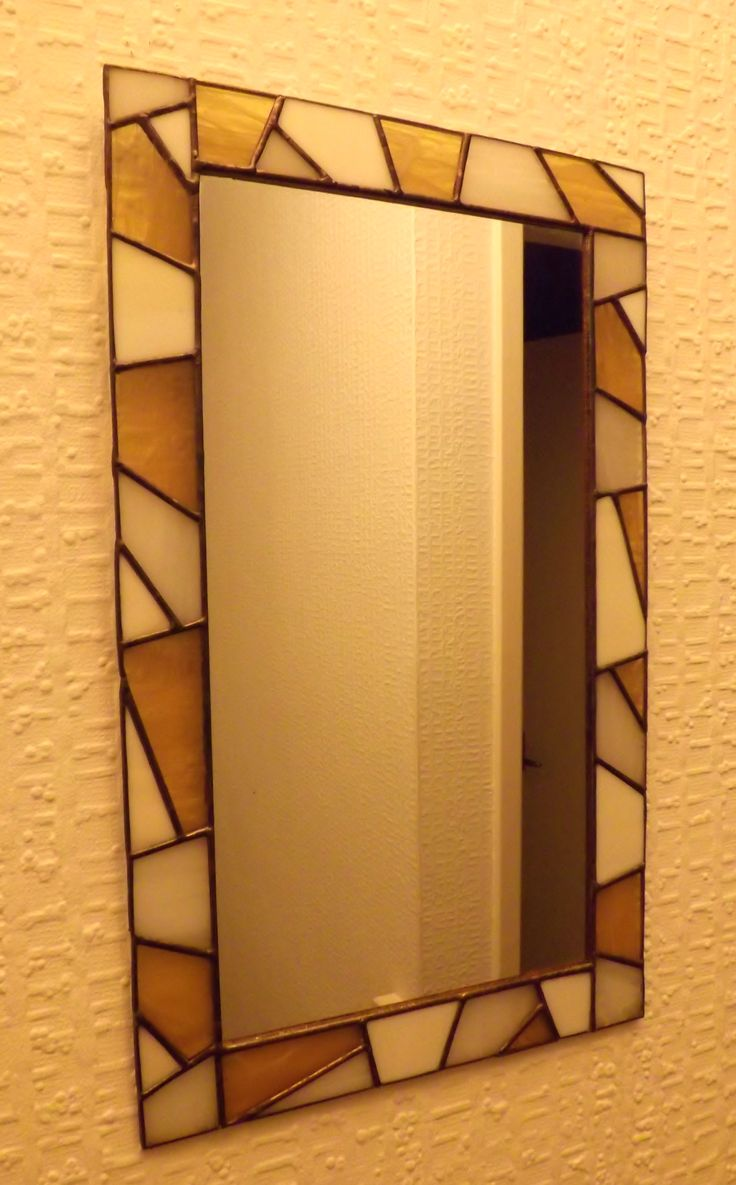 Stained glass mirror made mostly with off cuts of glass from other projects.