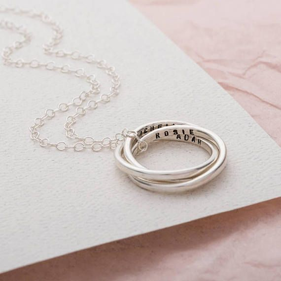A beautiful Personalised Secret Russian Ring Necklace handmade by Posh Totty Designs. This gorgeous new design is based upon our bestselling Personalised Russian Ring necklace and is a new addtion to our Russian Ring Collection.The Personalised Secret Russian Ring Necklace has three