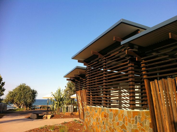 A public amenities building with Ritek roof flat panels situated in a beachfront location.