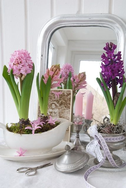 Flowers arranged against mirrors generate more color and give the illusion of more space. White rooms also allow flowers to really bring the room to life!