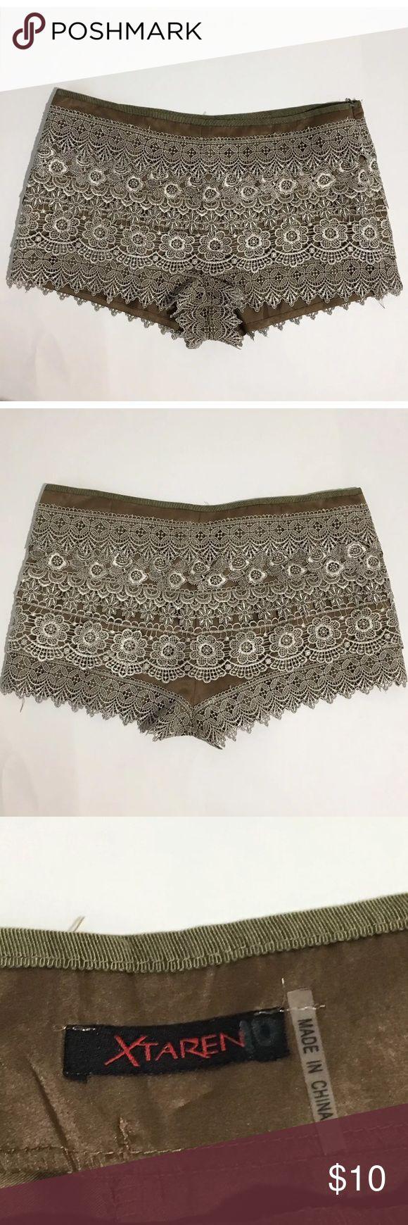 "Xtaren Women's Gold Lace Mini Shorts Shorts Women's Xtaren gold faux satin and lace shorts with side zipper. No size tag or care tag. waist is 16"" laying flat, 10"" waist to hem. Xtaren Shorts"