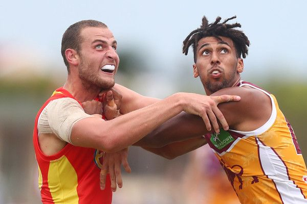 Jarrod Witts of the Suns and Archie Smith of the Lions compete for the ball during the 2017 JLT Community Series match at Broadbeach Sports Centre on February 19, 2017 in Gold Coast, Australia.
