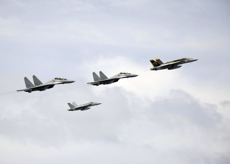 The Aviationist » Unusual formation: U.S. Navy F-18Es and Royal Malaysian Air Force Sukhoi Su-30s. Overflying USS George Washington