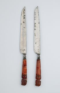 Pair of knives  Amber and steel  Origin: North Germany or Baltic region  Date: Second half 17th century  22.4 cm and 22.5 cm length  Bequeathed by J. Francis Mallett, 1947  Amber was found in East Prussia and along the Baltic coast and first exploited on a commercial scale by Duke Albrecht of Prussia (1490-1569).
