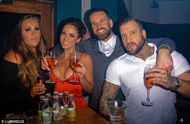 Tan-tastic! Vicky poses for a picture with her boyfriend and two (equally tanned) friends...