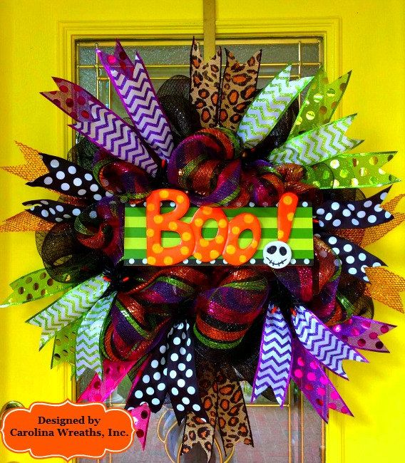 "Beautiful 30""+ Halloween Deco Mesh Wreath in Premium Shimmering Black and Shimmering Multi-Color (Black, Purple, Fuchsia, Lime, Orange). Features a Wooden Centerpiece that reads ""BOO."" Various Accent Ribbons. Comes to Life at Night when you Plug it in to Show Off the Twinkling/Blinking Orange Lights!"