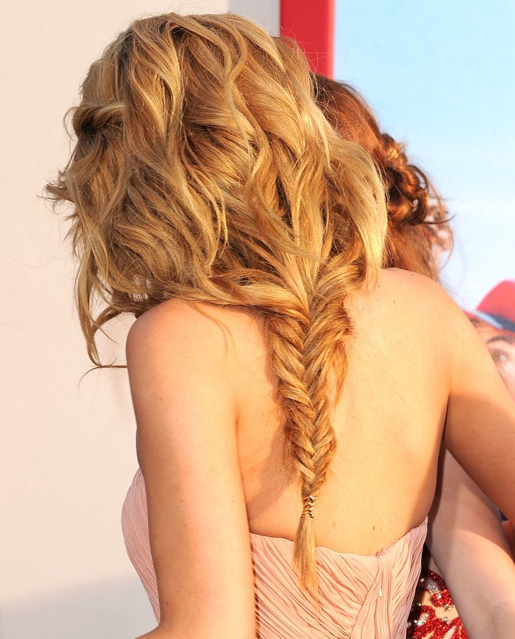 Bella's wavy hairstyle was actually pulled into a loose fishtail braid in the back.