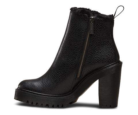 This is the Magdalena, a woman's high-heeled ankle zip boot. First things first: extra height and street cred come in the form of an edgy, tough heel. The boot's got the same durable ass-kicking Buffalo style as the original—but it's winter-ready in a rich, warm Ted Fur lining. The Magdalena zip bootie is made with the iconic air-cushioned sole, that's oil-and-fat resistant with good abrasion and slip resistance—and has been since 1960. The sole is cemented to the upper, but retains its ...