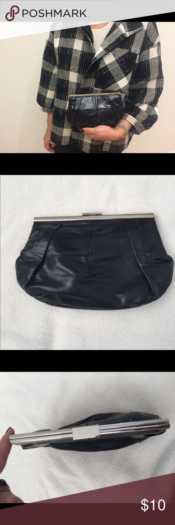 Banana Republic Leather Clutch Great condition black cow leather Clutch from Banana Republic.  Great little purse for going out, fits iPhone and credit cards with a lipstick.  Actually expands to get wider.  The size is about 9 inches and 6 inches tall. Banana Republic Bags Clutches & Wristlets