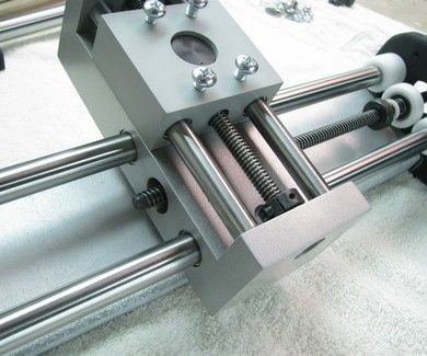 Clamp together delrin POM halves onto rods and bolt together to make cnc assembly.