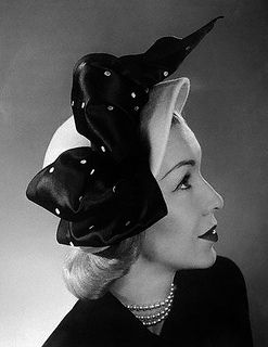 Claude Saint-Cyr of Paris has created this hat - a profile cloche of powder-blue felt, trimmed with soft bows of white-dotted navy satin ribbon.  1940s  Image by © Bettmann/CORBIS