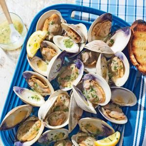 Grilled Clams with White Wine-Garlic Butter   MyRecipes.com Meaty cherrystone clams are larger than delicate littlenecks, so they stand up to grilling. And because they take longer to cook, they have plenty of time to soak up all that smoky flavor.