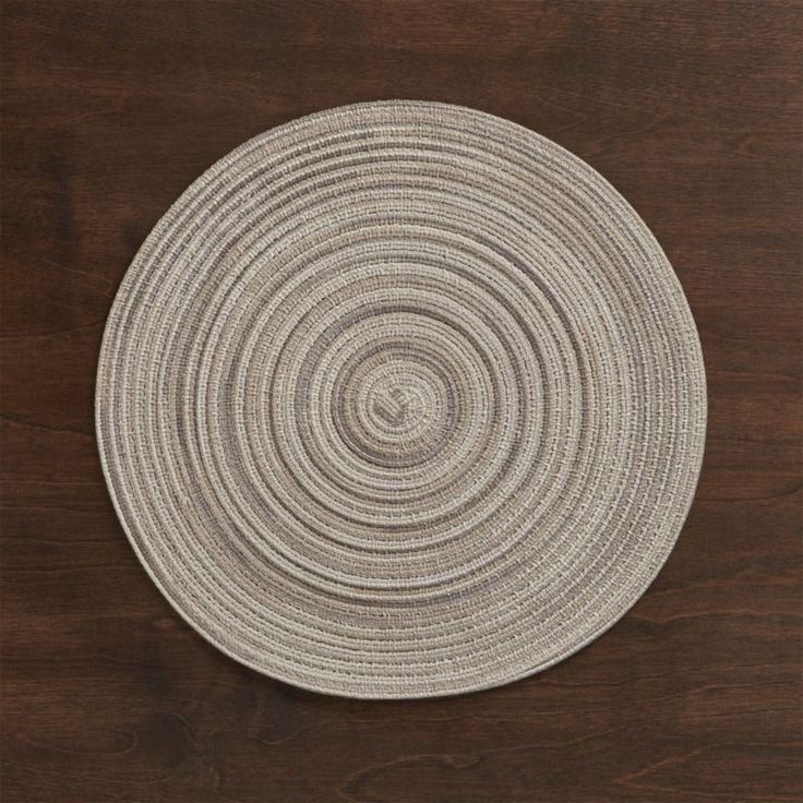 Ombre color swirls an easy-care polyester placemat that looks great and wipes up clean.100% polyesterWipe clean with damp clothMade in China