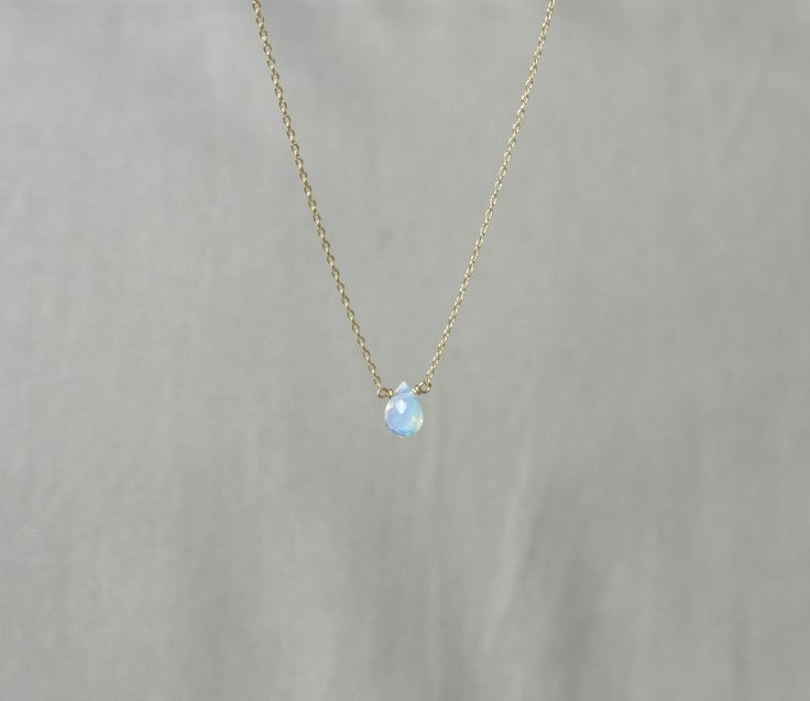 Delicate simple everyday teardrop opal gemstone gold necklace available in gold or silver. $16.00, via Etsy.