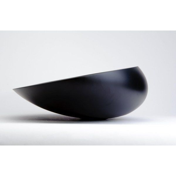 This uniquely shaped vessel sink wraps around itself in the back and it is slightly declined towards the front. Kool is made out of a material called Vetro Fredo which is a mixture of glass pigments and resin that makes it extremely resilient to high and low temperatures. The general outline is elliptical. Due to its small size and lightweight, this small vessel sinks is ideal for small spaces with sleek and narrow bathroom countertops or bathroom vanities.