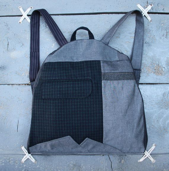 """Eating the goober"" handmade backpack made from recycled clothes, (men's suits & shirts) and brand-new textiles.Colors : different shades of grey, green, black"