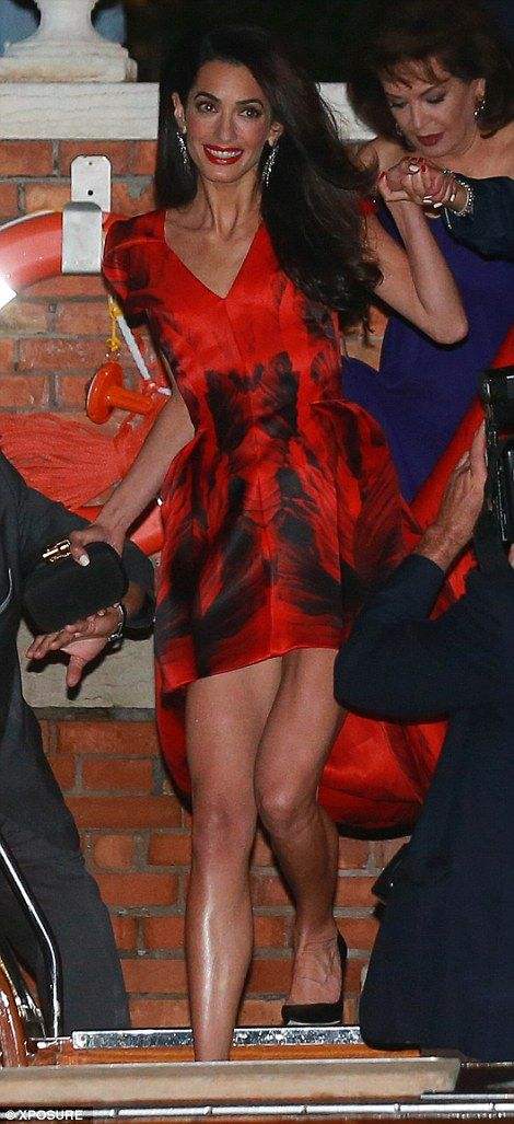 Amal Alamuddin - Stunning: The British human rights lawyer looked glamorous in a red and black gown featuring a waterfall skirt as she is helped onto a speed boat in Venice on Friday night