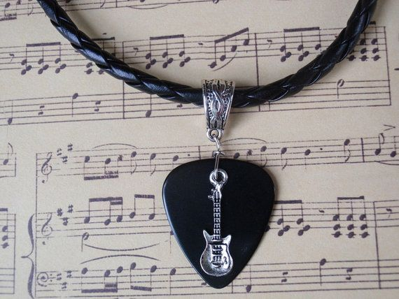 Your choice of one guitar on a guitar pick necklace made with a custom sized braided pleather chain. I made this necklace with a real guitar pick, the kind musicians use to play guitars with!! The bail is Tibetan silver. This necklace makes a great gift for anyone who plays or loves the violin and music. Guitars are Tibetan Silver and are separate from guitar pick. Last picture shows choices. ~♥*¨•♫•*~♥♥~♫•*¨`*•♫~♥~  I make my own chains so you may select the size you desire! I make all ...