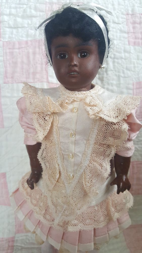 SHE'S AN ANTIQUE BLACK MULATTO WITH A BISQUE HEAD AND A COMPOSITION BALL JOINTED BODY MADE IN GERMANY. POSSIBLE KESTNER. SHE IS JOINTED WITH HER ORIGINAL COMPOSITION WOODEN LIMBS AND IS MARKED ON THE BACK OF HER HEAD DEP 247 MADE IN GERMANY. | eBay!