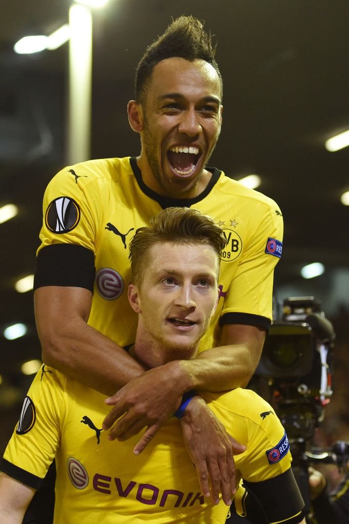Pierre- Emerick Aubameyang Photos Photos - Marco Reus of Borussia Dortmund celebrates scoring his team's third goal with Pierre-Emerick Aubameyang during the UEFA Europa League quarter final, second leg match between Liverpool and Borussia Dortmund at Anfield on April 14, 2016 in Liverpool, United Kingdom. - Liverpool v Borussia Dortmund - UEFA Europa League Quarter Final: Second Leg