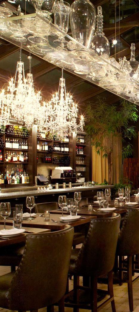 Atrium-style restaurant Isola Trattoria & Crudo Bar serves fresh Italian cuisine. #NYC