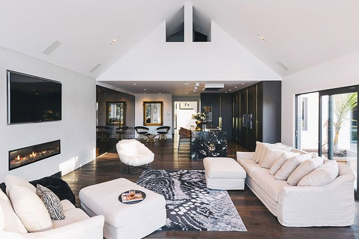 Open planned living area with an Escea DX1500 multiroom gas fire