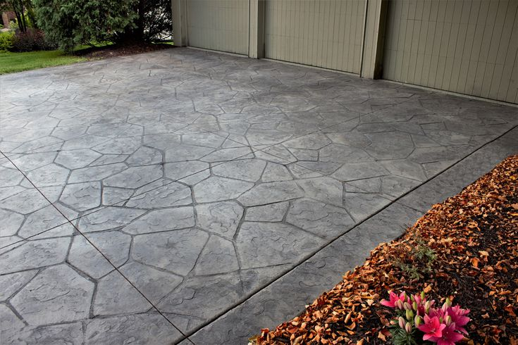 Decorative gray flagstone stamped concrete driveway
