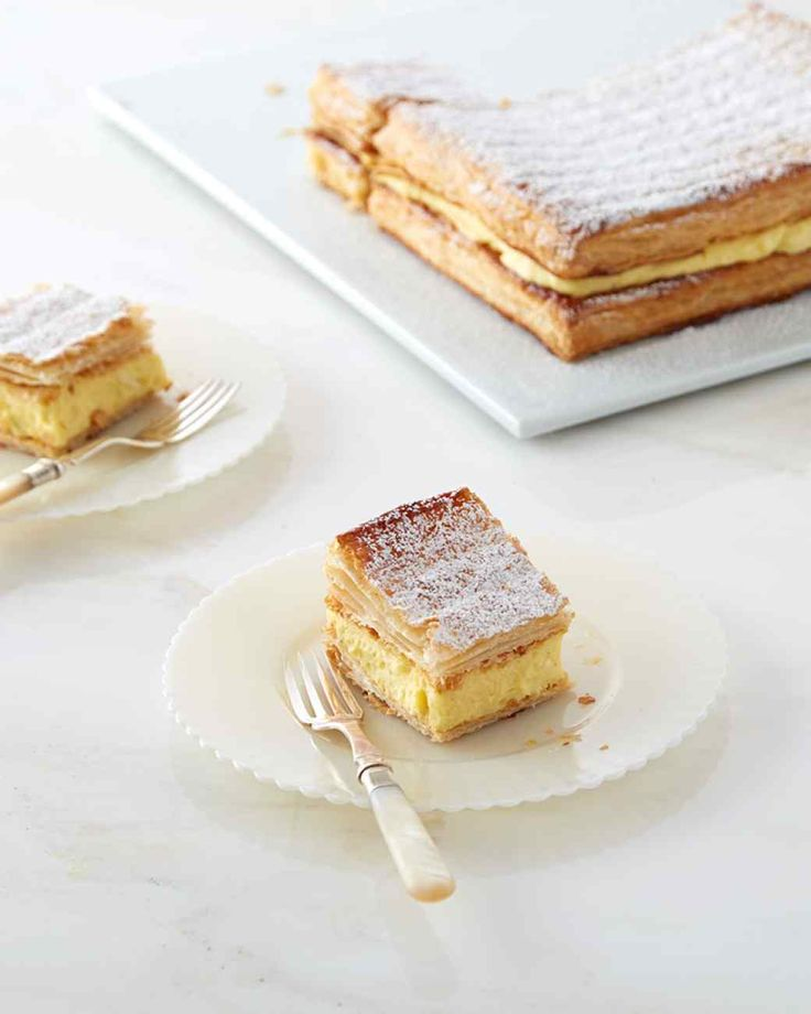 Kremowka - a Polish cream cake that sandwiches vanilla pastry cream between two layers of puff pastry.