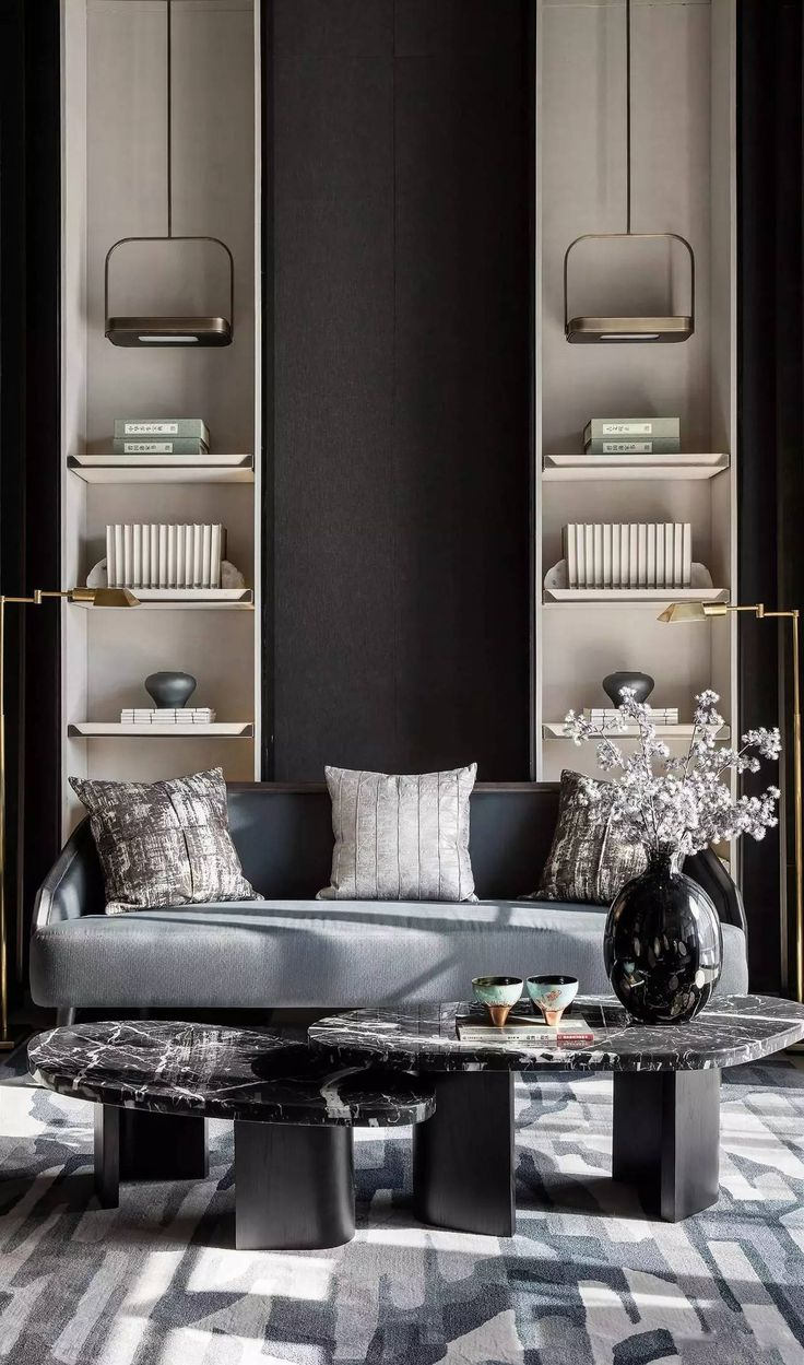 In a gray living room, white flowers in a black vase are right at home - 25+ Best Ideas About Black Living Rooms On Pinterest Cute Living