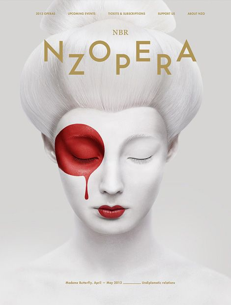 NZ Opera photo - all white geisha with red lip and circle of blood over eye