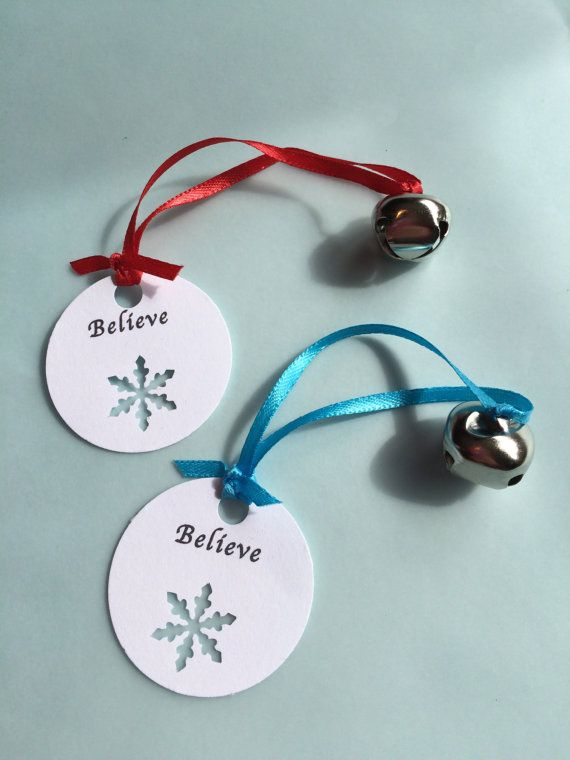 Each silver jingle bell is approx 1/2 inch, hand tied onto a 1/8 inch thick satin ribbon with a Believe tag with snowflake cut out. Perfect for a holiday party favor, Christmas party favor, Class christmas or holiday gifts for school, teacher gift, a polar express party favor or as a decoration for your christmas tree. Available with either blue or red satin ribbon - please select from the drop down menu when ordering. If you would like a different color, let us know - we will if we can…