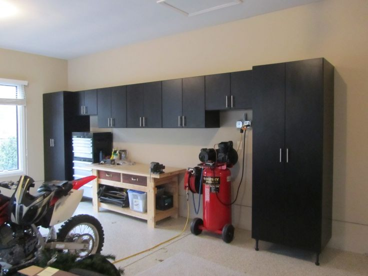 Black cabinets suit this man cave - by Garage Designs of St Louis