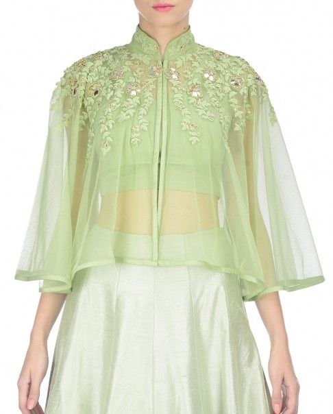 Mint green Lehenga with fine pleats. This set comes a matching sheer cape featuring floral dori embroidery and mirror work. High collar with hook and eye detail. Wash Care: Dry clean onlyMatching bustier includedClosure: Zip at side