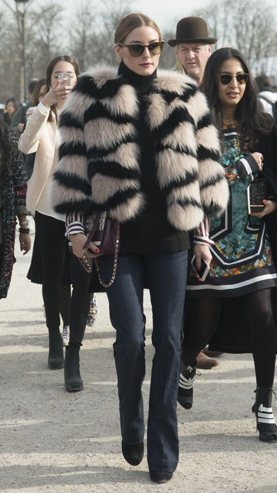 While the '70s redux was playing out on the runway, Olivia was already trialling it front row