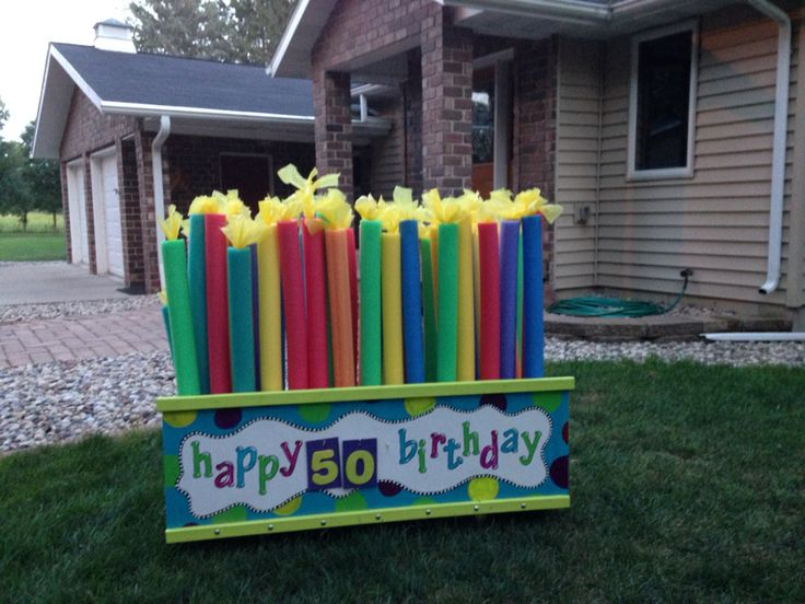Pool noodle birthday candles. Sign folds down for storage. Noodles stand on…
