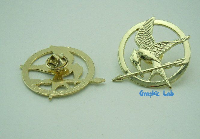 Hunger Games mockingjay pin by GraphicLabStore on Etsy https://www.etsy.com/listing/224197652/hunger-games-mockingjay-pin