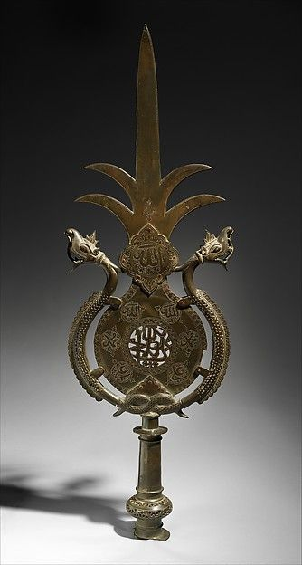 Standard ('Alam) Object Name: Standard Date: late 17th–early 18th century Geography: India, Deccan Culture: Islamic Medium: Brass Dimensions: H. 38 in. (96.5 cm) W. 12 in. (30.5 cm) Classification: Metal Credit Line: Purchase, Friends of Islamic Art Gifts, 2013