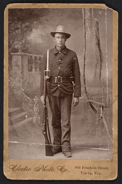 Spanish American War, Infantry, holding Krag rifle with fixed bayonette, cartridge belt, 1898.  Electro Photo Co., 909 Franklin Street, Tampa, Fla.